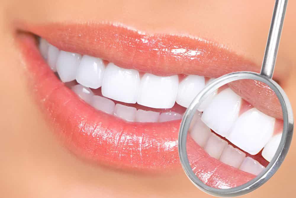 dental instrument examining white teeth